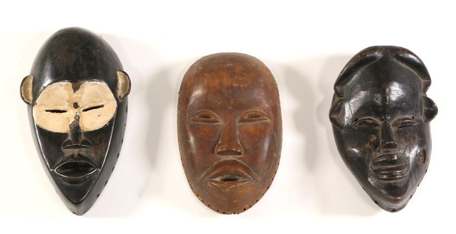 Ivory Coast, three Dan masks, one with painted accents in white kaolin., h. 27, …