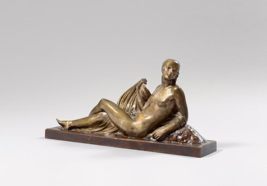 Joe DESCOMPS-CORMIER (1869-1950) La femme au turban allongée. Bronze à deux patines…
