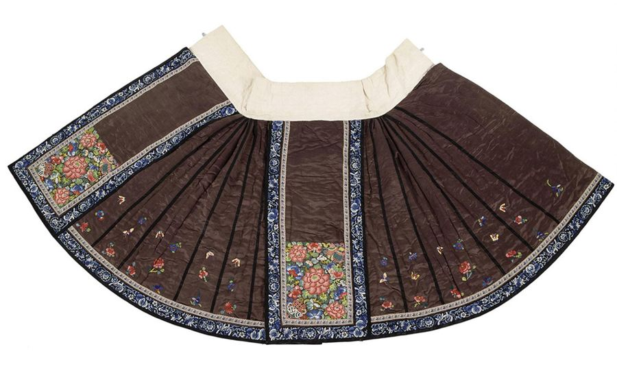 A FINE PADDED SILK SKIRT WITH POLYCHROME FLOSS SILK EMBROIDERY, China, late Qing…