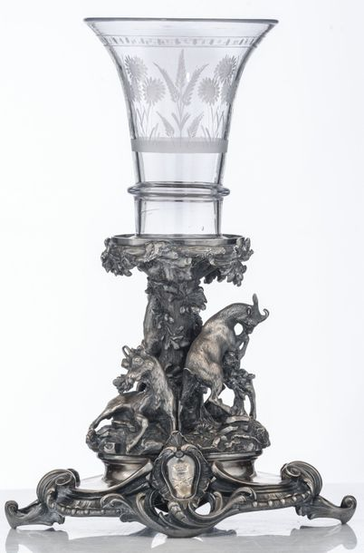 An imposing silver plated piece de milieu, the base modelled as a pastoral scene…