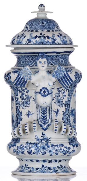 A blue and white Dutch Delftware covered vasewith twin handles in the form of w…