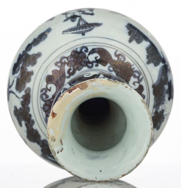 A blue and white decorated Dutch Delftware garlic neck bottle vase with a chinoi…