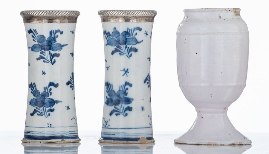 A pair of Dutch Delftware blue and white trumpet shaped vases, with a chinoiseri…