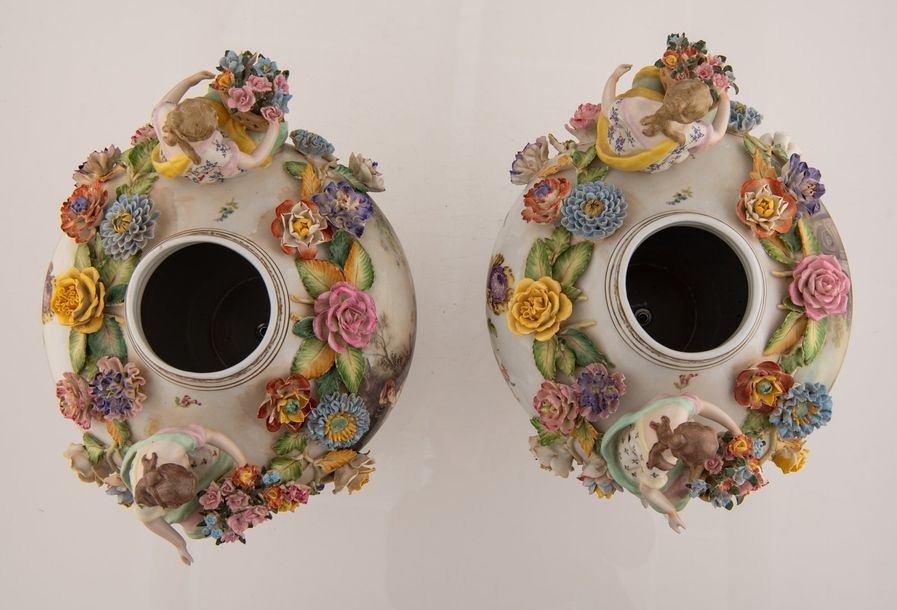 A pair of Saxony porcelain vases and covers, decorated with transfer printed gal…