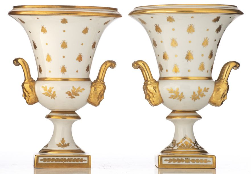 A pair of Limoges porcelain vases, gilt decorated in the Napoleonic manner with …