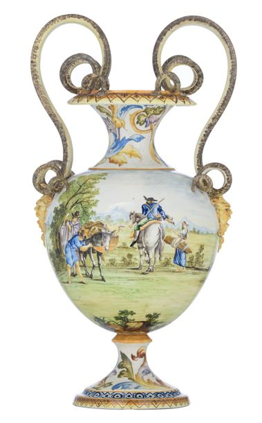 An imposing floral decorated Renaissance inspiredmajolica vase, with double snak…