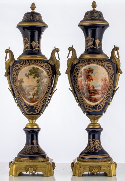 An imposing pair of bleu royale ground covered vases in the Sèvres manner, with …