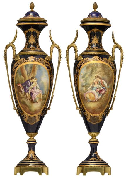 A pair of covered Sèvres type vases, bleu royale ground and the roundels polychr…