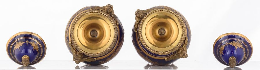 A pair of covered bleu royale ground vases in the Sèvres manner, with gilt bronz…