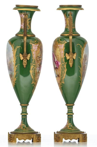A pair of Sèvres type vases, green ground and the roundels polychrome decorated …