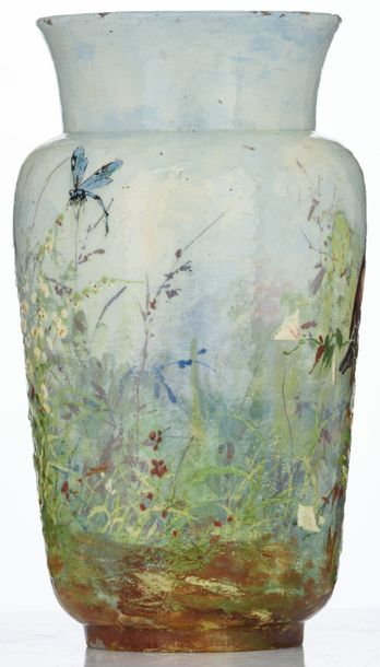 A French earthenware vase with relief painted decoration, depicting birds feedin…