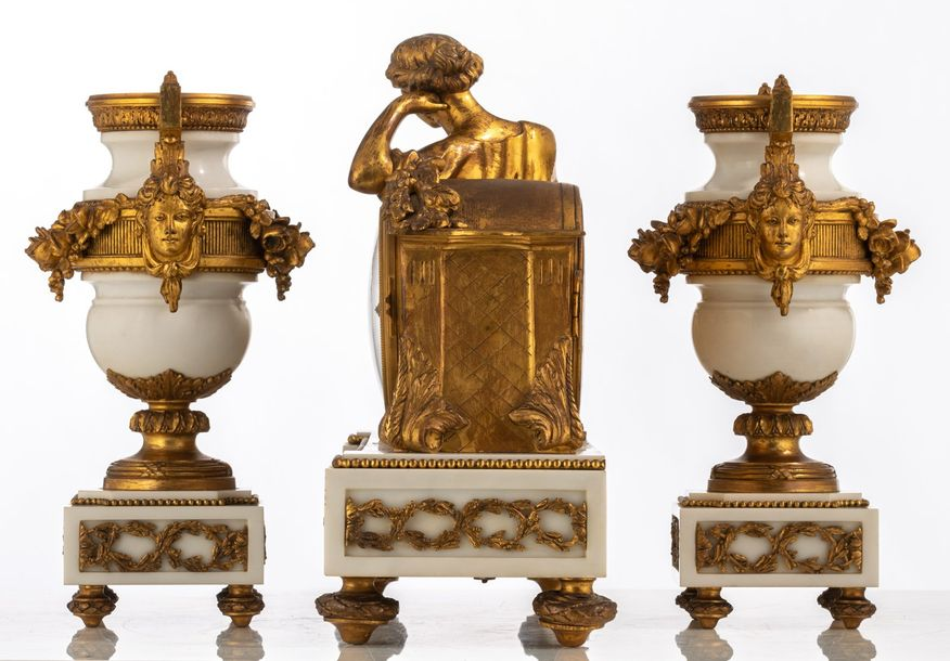A Neoclassical three piece Carrara marble garniture, consisting of a pair of vas…