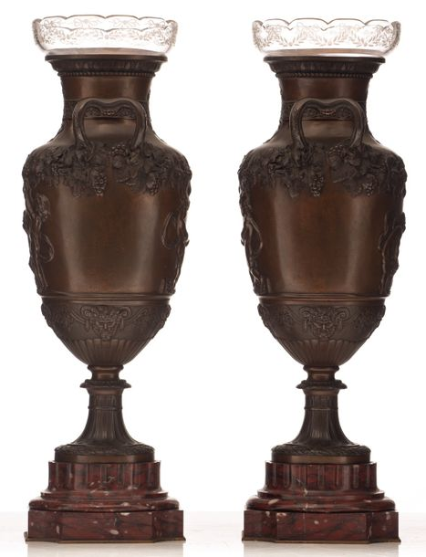 A pair of Neoclassical patinated bronze flower vases on a rouge royal marble bas…