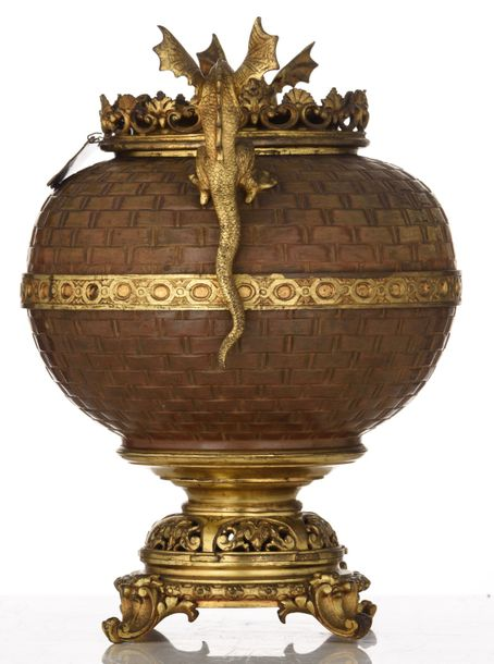 A patinated and gilt bronze vase, the body with imitating basketry and two drago…